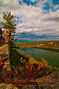 Hiker's enjoy gorgeous autumn foliage and cliffs under moody skies along the West Bluff Trail within Devils Lake State Park (USA WI Baraboo)