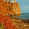Blazing autumn foliage and bright blue skies frame cliff top Split Rock Lighthouse Minnesota State Historic Site on Lake Superior (USA MN Two Harbors; RAO 2012 Nikon D300s Image 3820)