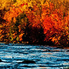 Crimson autumn foliage embraces Sherry Rapids along the wild Wolf River (USA WI White Lake)