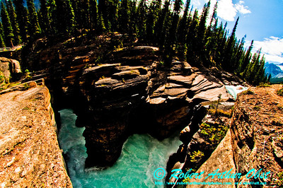 Hiker's view of the Mistaya River as it exits the Waputik Mountains and plunges through Mistaya River Canyon within Banff National Park (Canada AB Saskatchewan Crossing)