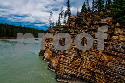 Hiker's view of the colorful confluence of the Sunwapta and Athabasca Rivers within Jasper National Park (CAN Alberta Jasper)