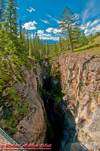 Blue skies over deep dark limestone gorge of the Maligne River Canyon within Jasper National Park (Canada Alberta Jasper)