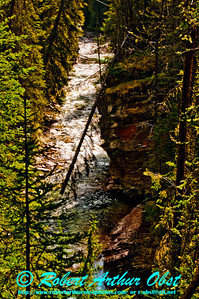 Hiker's view of clear champagne waters of Johnston Creek within Johnston Canyon and Banff National Park (CAN Alberta Banff)