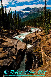 The Waputik Mountains and Mount Sarbach frame the rapids filled Mistaya River Canyon within Banff National Park (CAN AB Saskatchewan Crossing)