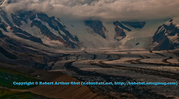 Clouds and Snow and ice walls embrace the second highest volcano in the USA called Mount Blackburn at the head of Kennicott Glacier within Wrangell St. Elias National Park and Preserve (USA Alaska McCarthy)