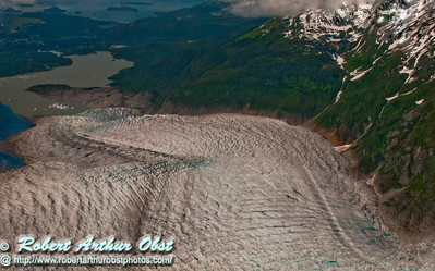 Ambitious hikers and ice climbers and float plane or helicopter riders will enjoy views of the twelve miles long Mendenhall Glacier within Tongass National Forest curving to meet Auke Bay and the Pacific Ocean (USA Alaska Juneau)