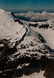 Icy Coast Mountains and Amherst Peak tower over glaciers and the Juneau Icefield within Tongass National Forest (USA Alaska Juneau)