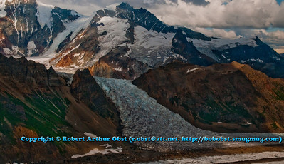Colorful mountains embrace the top of Kennicott Glacier near Mount Blackburn northwest of Kennicott within Wrangell St. Elias National Park and Preserve (USA Alaska McCarthy)