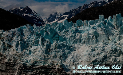 Blue skies and cotton candy clouds over Margerie Glacier and Tarr Inlet and Mount Forde within Glacier Bay National Park and Preserve (USA AK Gustavus)