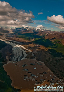 View of Nizina Glacier and its base chocolate outflow running off Regal Mountain within Wrangell St. Elias National Park and Preserve (USA Alaska McCarthy)