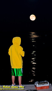 Gorgeous full 2012 Autumnal Equinox Harvest Moon rising over youth fisherman on the Lake Street Dock by Captain Bill's Waterfront near the outlet of Pheasant Branch Creek Conservany (USA WI Middleton; RAO 2012 Nikon D800 Image 6319-1)