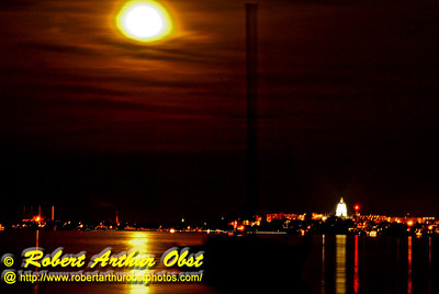 Moon glows golden over Lake Mendota sailboats and Wisconsin's Madison Capitol (USA WI)