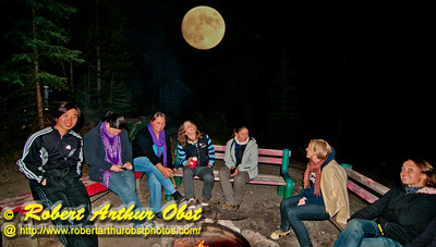 Moon rise over the Beauty Creek Wilderness Youth Hostel camp fire within Jasper National Park (CAN Alberta Jasper)