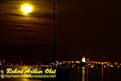 Moon glows golden over Lake Mendota sailboats and Wisconsin's Madison Capitol (USA WI Madison)