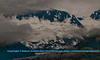 Eerie swirling fog and clouds embrace the glaciers and snowy mountains of College Fjord within northern Prince William Sound near the Gulf of Alaska (USA Alaska Whittier College Fjord; Obst FAV Photos 2011 Nikon D300s Image 8618)
