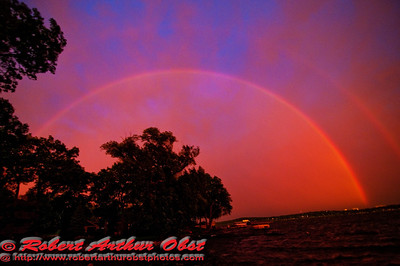 Dazzling Iridescent Rainbow at Sunset during a rainstorm over Lake Mendota Park (USA WI Middleton)