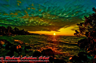 Spectacular sunset over Lake Superior's Copper Harbor radiating red upon the wild shores of Lake Shore Drive Town Park on the Keweenaw Peninsula of Michigan (USA MI Copper Harbor)