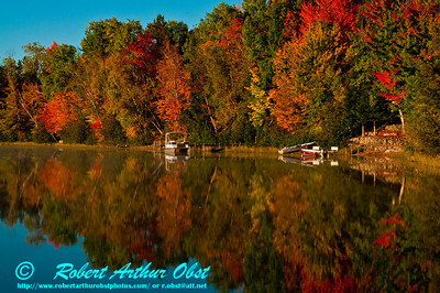 View from a canoe of Autumn Reflections and Cobalt Skies over Serene Otter Lake near Elcho (USA WI Elcho)