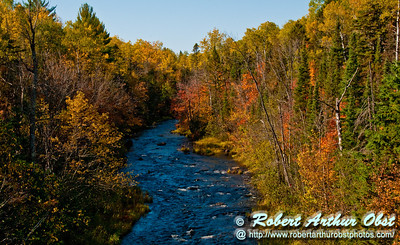 Blazing autumn colors frame the wild West Branch of the Ontonagon River north of MI Highway 28 within the Upper Peninsula of Michigan (USA MI Ontonagon)