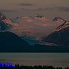 Crimson sunrise over Grewingk Glacier and the Kenai Mountains within Kachemak Bay State Park on the Kenai Peninsula (USA Alaska Homer)