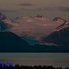 Crimson sunrise over Grewingk Glacier and the Kenai Mountains within Kachemak Bay State Park on the Kenai Peninsula (USA Alaska Homer)