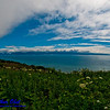 Blue skies and fog over Kachemak Bay near the Sterling Highway by Homer on the western Kenai Peninsula of Alaska (USA Alaska Homer)
