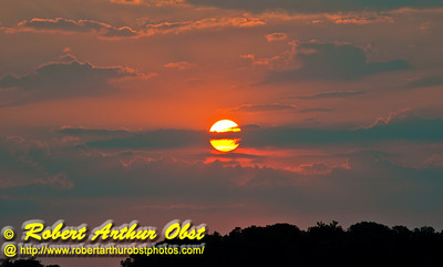 Crimson sunset over ohio woodlands from US Highway 27 northwest of Oxford and Miami University of Ohio (USA OH Oxford)