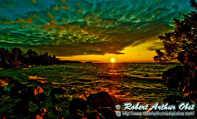 Spectacular sunset over Copper Harbor radiating red upon Lake Shore Drive Town Park or Hobard State Park on the Keweenaw Peninsula of Michigan (USA MI Copper Harbor; 7661 with horizon straightened)