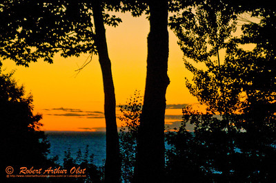 Sunset afterglow silhouetting trees from our Presque Isle Scenic Area campsite within Porcupine Mountains Wilderness State Park (USA MI Ontonagon)