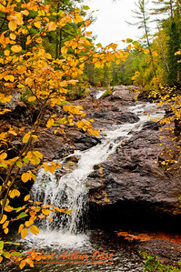 Blazing autumn foliage frames Amnicon Falls within Amnicon Falls State Park (USA WI South Range; RAO 2012 Nikon D300s Image 3800)