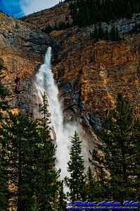Spectacular Takakkaw Falls springs from Daly Glacier near the Yoho River within Yoho National Park (Canada BC Field)