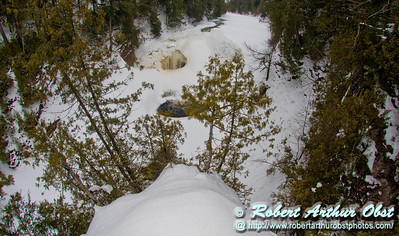 Back country skier's and snowshoer's precipitous view during winter of a frozen Potowatomi Falls and canyon on the National Wild and Scenic Black River within the Black River Recreation Area of the Ottawa National Forest (USA MI Bessemer; Obst FAV Photos 2013 Nikon D800 Landscapes Inspirational Image 8075)