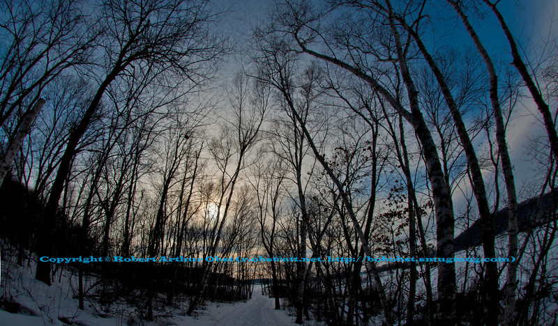 Cross country skier's view of afternoon winter sun over hardwood forests and a frozen Indian Lake within Indian Lake County Park (USA WI Cross Plains; Obst FAV 2013 Landscapes Inspirational Winter Beauty Image 7802)