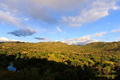 View at the Sierra de Andújar (the stronghold of the Iberian Lynx, the rarest feline in the world) in the golden hour. Photo taken from at west bank of the Río Jándula (Jáen, Spain) on 3 May, 2010.
