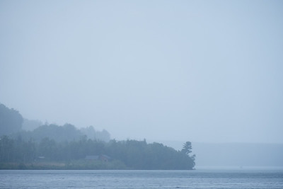 A light rain mixed with fog on the southern shore of Lake Superior.