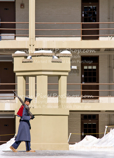 VMI guard marching inside barracks.