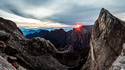 Sunrise as seen over Low's Gully and ugly sister peak, from the base of Low's peak (Approx 4000 metres) Mount Kinabalu.