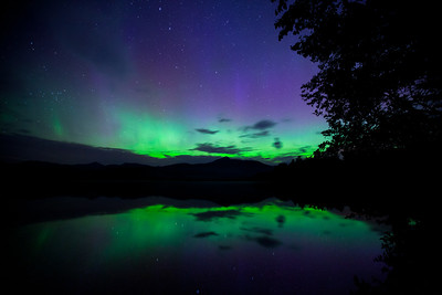 Aurora borealis over lake Chocorua, New Hampshire, USA