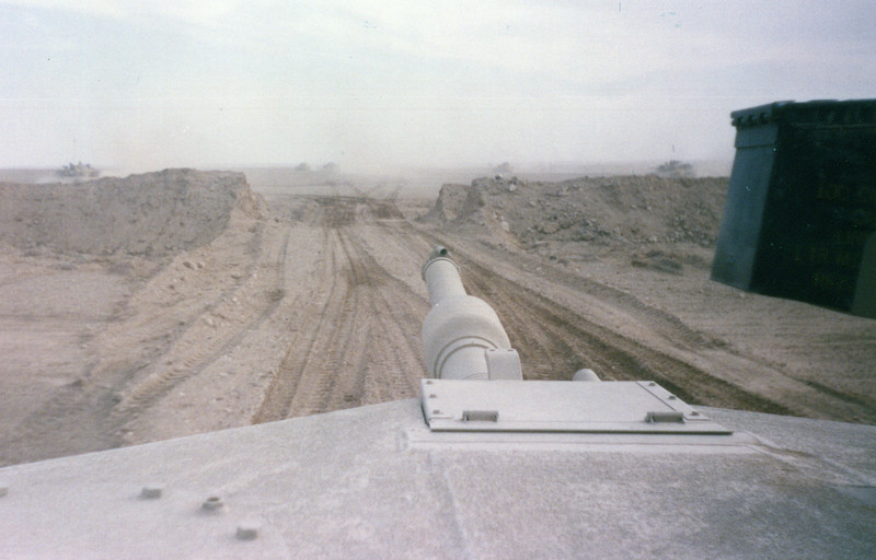 M1 tank crossing berm into Iraq Desert Storm