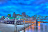 Artistic view of downtown Louisville from the riverfront with Joe's Crab Shack in the foreground and the now fully built Yum Center Arena for the University of Louisville right behind.