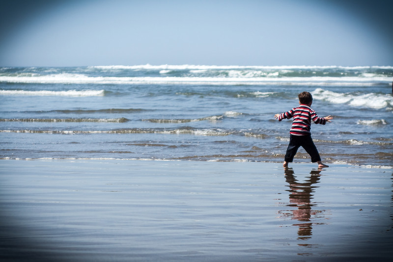 Boy yelling at ocean waves