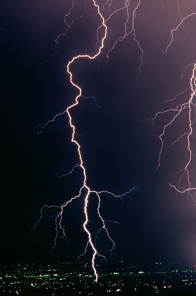 """A real lightning bolt strike in a metropolitan area. Click the """"Buy"""" or shopping cart button (above the image) to purchase prints or downloads."""