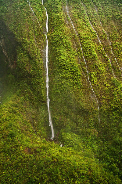 """Waterfalls inside the crater of Mount Waialeale (Wai'ale'ale or """"Rippling Water""""), Kauai, Hawaii. This is an aerial photo taken from a helicopter."""