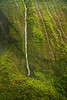 "Waterfalls inside the crater of Mount Waialeale (Wai'ale'ale or ""Rippling Water""), Kauai, Hawaii. This is an aerial photo taken from a helicopter."