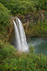 "Wailua Falls plunges down into a quiet pool - Kauai, Hawaii. (To purchase prints or downloads, click on the ""Buy"" or shopping cart button above the image.)"
