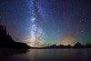 Starry night sky and Milky Way over Jackson Lake and Tetons, Grand Teton National Park