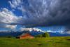 Morning thunderstorm passes over Grand Teton National Park and Moulton Barn, Mormon Row.