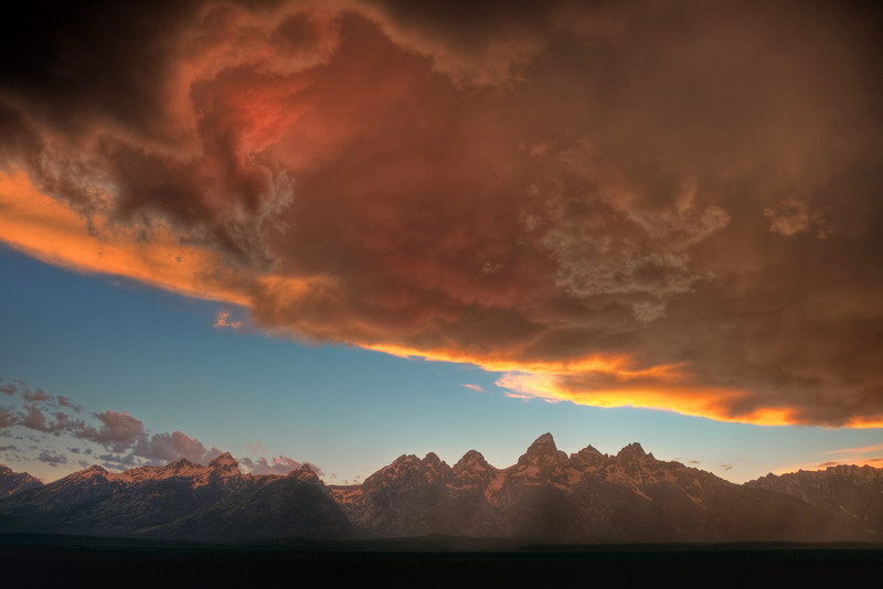 """A summer thunderstorm begins to clear away from the Grand Tetons at sunset. (To purchase prints or downloads, click on the """"Buy"""" or shopping cart button above the image.)"""