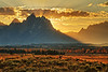 Sunset behind Grand Tetons, with rustic rail fence in foreground - Grand Teton National Park