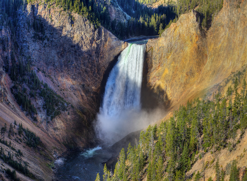 Lower Yellowstone Falls, Yellowstone National Park, USA. The lower falls are 308 feet (94 m) high, and is the largest volume major waterfall in the Rocky Mountains of the United States.